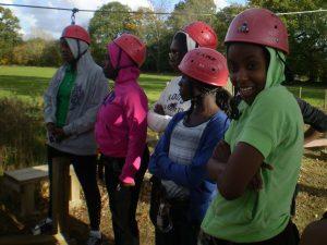 Group of girls preparing to rock climb